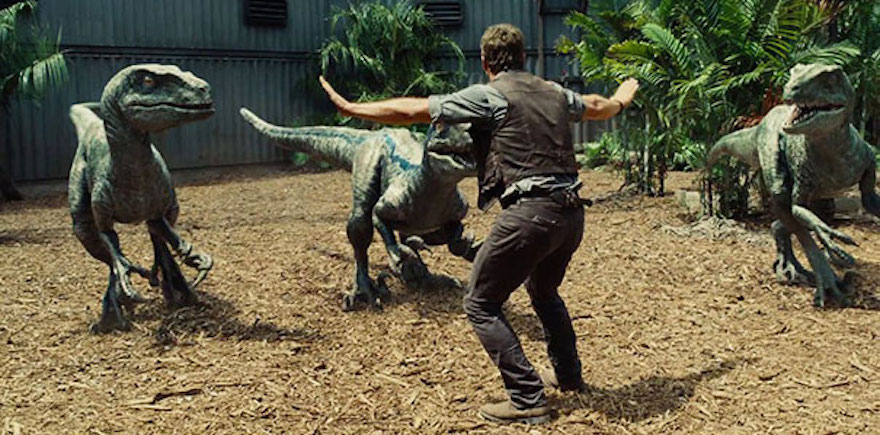 Chris Pratt holding raptors at Bay in Jurassic World